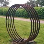 "Five Ring, 1990, steel, 65"" dia."